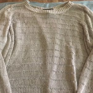 Cable knit sweater with flybaway back